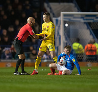 Referee Darren Drysdale discusses Fleetwood Town's Paul Coutts (centre) tackle on Portsmouth's Andy Cannon (right) <br /> <br /> Photographer David Horton/CameraSport<br /> <br /> The EFL Sky Bet League One - Portsmouth v Fleetwood Town - Tuesday 10th March 2020 - Fratton Park - Portsmouth<br /> <br /> World Copyright © 2020 CameraSport. All rights reserved. 43 Linden Ave. Countesthorpe. Leicester. England. LE8 5PG - Tel: +44 (0) 116 277 4147 - admin@camerasport.com - www.camerasport.com