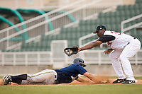 Charleston's Chris Malec (17) dives back to first base as Kannapolis' Chris Carter fields the pick-off throw at Fieldcrest Cannon Stadium in Kannapolis, NC, Wednesday, April 18, 2007.  The River Dogs defeated the Intimidators by the score of 1-0.