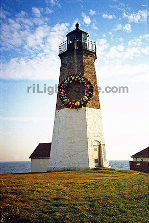 A wreath of buoys adorns the Watch Hill Lighthouse