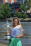 Victoria Azarenka displays the winner's trophy from the Australian Open, 2012 in Melbourne, Australian