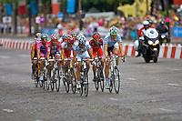 A small breakway of eleven riders lead the way on the Champs Elysees, Paris, during the final stage of the 2010 Tour de France