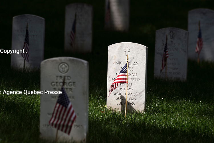 Flags adorn graves at Arlington National Cemetery for Memorial Day May 29, 2017. (DoD photo by EJ Hersom)