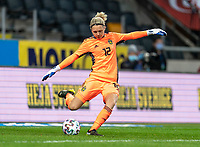 SOLNA, SWEDEN - APRIL 10: Jennifer Falk #12 of Sweden kicks the ball during a game between Sweden and USWNT at Friends Arena on April 10, 2021 in Solna, Sweden.