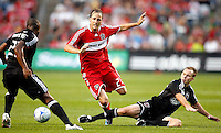 DC United defender Bryan Namoff (26) trips Chicago Fire midfielder Justin Mapp (21) while DC United defender Gonzalo Martinez (23) looks on.  The DC United defeated the Chicago Fire 2-1 at Toyota Park in Bridgeview, IL on June 7, 2008.