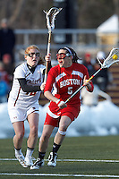 Boston University attacker Elizabeth Morse (5) on the attack as Boston College defender Kara O'Connell (10) defends..Boston College (white) defeated Boston University (red), 12-9, on the Newton Campus Lacrosse Field at Boston College, on March 20, 2013.