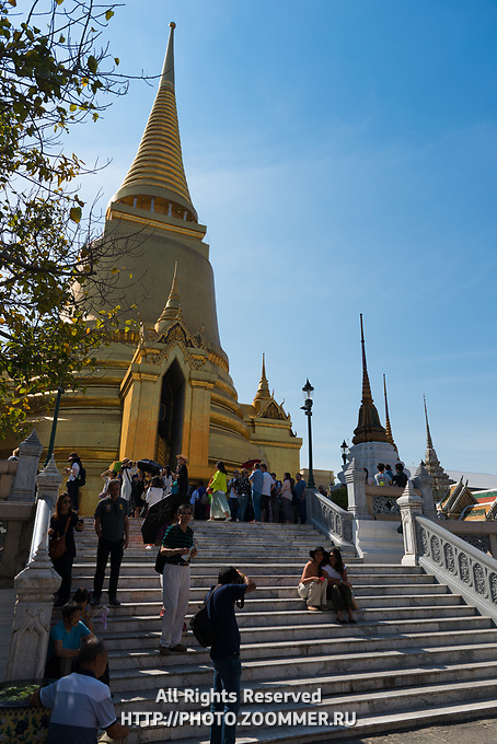 Tourists near Phra Si Rattana Chedi in the Emerald Budda Temple, Bangkok, Thailand