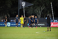 LAKE BUENA VISTA, FL - JULY 26: Gianluca Busio of Sporting KC gets a tap on the head from Luis Martins of Sporting KC following his clinching shootout goal during a game between Vancouver Whitecaps and Sporting Kansas City at ESPN Wide World of Sports on July 26, 2020 in Lake Buena Vista, Florida.