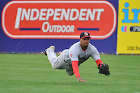 Right Fielder Henry Ramos (19) of the Portland Sea Dogs makes a diving catch during a game against the New Britain Rock Cats at New Britain Stadium on May 15, 2014 in New Britain, Connecticut.  Portland defeated New Britain 13-5.  (Gregory Vasil/Four Seam Images)