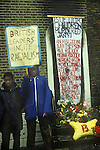 New Cross Fire Massacre March 1981. Local people gather outside the house in New Cross where 13 young adults died in a blaze.  1980s UK.<br /> The New Cross Fire was a devastating house fire which killed 13 young black people during a birthday party in New Cross, southeast London on Sunday 18 January 1981. Some were shocked by what they perceived as the indifference of the white population, and accused the London Metropolitan Police of covering up the cause, which they suspected was an arson attack motivated by racism; the protests arising out of the fire led to a mobilisation of black political activity. Nobody has ever been charged in relation to the fire