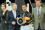 Team magic: Rider Roger-Yves Bost of France and Jockey Joao Moreira of Brazil win the Hong Kong Jockey Club Race of the Riders, part of the Longines Masters of Hong Kong on 10 February 2017 at the Asia World Expo in Hong Kong, China. Photo by Marcio Rodrigo Machado / Power Sport Images