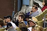 Player Agent Scott Boras talks on the phone during a game between the Milwaukee Brewers and the Los Angeles Dodgers at Dodger Stadium on May 31, 2012 in Los Angeles,California. Milwaukee defeated Los Angeles 6-2.(Larry Goren/Four Seam Images)
