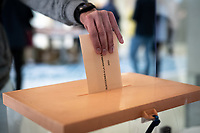 MADRID, SPAIN – MAY 04: A person casting her vote in the ballot box on 4 May in Madrid, Spain. (Photo by Joan Amengual / VIEWpress via Getty Images)