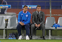 Injured Rio Ferdinand and David Beckham look miserable on the bench prior to the game with the USA. USA vs England in the 2010 FIFA World Cup in Rustenburg, South Africa on June 12, 2010.