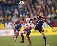 FC Dallas forward/midfielder David Ferreira (10) controls a head ball as New England Revolution midfielder Chris Tierney (8) defends. The New England Revolution defeated FC Dallas, 2-1, at Gillette Stadium on April 4, 2009. Photo by Andrew Katsampes /isiphotos.com
