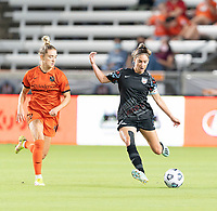 HOUSTON, TX - SEPTEMBER 10: Morgan Gautrat #13 of the Chicago Red Stars passes the ball in front of Kristie Mewis #19 of the Houston Dash during a game between Chicago Red Stars and Houston Dash at BBVA Stadium on September 10, 2021 in Houston, Texas.