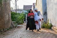 India, Gujarat, Bhadroi, Kutch Desert. Pabiben and her husband on the phone.
