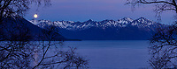 Spring landscape of full moon setting over snow-covered Kenai Mountains and Turnagain Arm at dawn, prior to sunrise.  Spring Southcentral, Alaska <br /> <br /> Photo by Jeff Schultz/  (C) 2020  ALL RIGHTS RESERVED