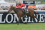 Golden Lilac, ridden by Maxime Guyon and trained by André Fabre, wins the Group 1 Prix de Diane at Chantilly Racecourse in France June 12, 2011.