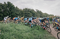 """peloton trying a short-cut<br /> <br /> Antwerp Port Epic 2018 (formerly """"Schaal Sels"""")<br /> One Day Race:  Antwerp > Antwerp (207 km; of which 32km are cobbles & 30km is gravel/off-road!)"""
