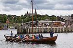 Denmark, Zealand, Roskilde: Tourists rowing Viking age replica ship at the Viking Ship Museum with the Domkirke behind | Daenemark, Insel Seeland, Roskilde: Touristen im einem Vikingerschiff Nachbau vom Wikingerschiffmuseum, im Hintergrund die Kathedrale von Roskilde