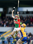 Ronan O Donnell of Clooney-Quin in action against Barry Fitzpatrick of  Sixmilebridge during their senior county final replay at Cusack park. Photograph by John Kelly.