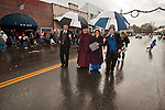 An 1890s vintage chorus signs carols as is walks Main Street during Ione Business and Community Association's annual Christmas parade  in the Mother Lode of Calif