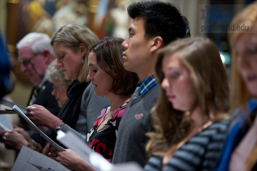 January 24, 2012; Haley Scott DeMaria (center) sings during the Mass of Remembrance for the 20th anniversary of the University of Notre Dame swimming team bus accident in the Basilica of the Sacred Heart. Photo by Barbara Johnston/University Photographer