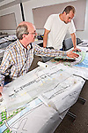 Senior male  student discusses drawing for landscape architectural class in night school in adult college education in California