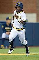 Michigan Wolverines second baseman Ako Thomas (4) sprints home against the Oakland Golden Grizzlies on May 17, 2016 at Ray Fisher Stadium in Ann Arbor, Michigan. Oakland defeated Michigan 6-5 in 10 innings. (Andrew Woolley/Four Seam Images)