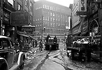 Pittsburgh PA:  View down Market Street toward Liberty Avenue after the Flood.  About 100,000 buildings were destroyed and the damage was estimated at about $250 million. 65 percent of the downtown business district had been underwater from the Point all the way up to Grant Street.