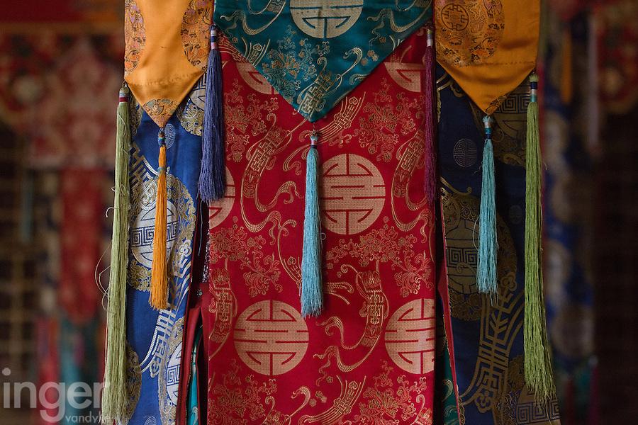 Brocades in the main prayer hall at Thiksey Monastery near Leh, Ladakh
