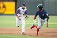 Winston-Salem Dash shortstop Cleuluis Rondon (13) chases Victor Robles (16) of the Potomac Nationals back towards first base at BB&T Ballpark on July 15, 2016 in Winston-Salem, North Carolina.  The Dash defeated the Nationals 10-4.  (Brian Westerholt/Four Seam Images)