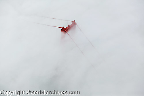 aerial photograph of the Golden Gate Bridge emerging through the fog, San Francisco, California