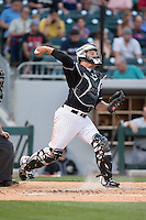 Charlotte Knights catcher Jeremy Dowdy (14) makes a throw to second base against the Columbus Clippers at BB&T BallPark on May 27, 2015 in Charlotte, North Carolina.  The Clippers defeated the Knights 9-3.  (Brian Westerholt/Four Seam Images)