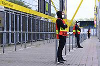 16th May 2020, Signal Iduna Park, Dortmund, Germany; Bundesliga football, Borussia Dortmund versus FC Schalke; Stewards with protective masks  stand in front of the Signal Iduna Park in Dortmund
