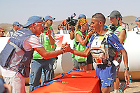 8th October 2021; Boulchrhal to Sud Jebel Irhfelt N'Tissalt ;  Marathon des Sables, stage 5 and final stage of  a six-day, 251 km ultramarathon, which is approximately the distance of six regular marathons. The longest single stage is 91 km long. This multiday race is held every year in southern Morocco, in the Sahara Desert. Rachid El Morabity is presented his winners medal by Patrick Bauer
