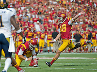 LOS ANGELES, CA - September 22, 2012:  USC kicker Andre Heidari (48) kicks the extra point during the USC Trojans vs the Cal Bears at the Los Angeles Memorial Coliseum in Los Angeles, CA. Final score USC 27, Cal 9..
