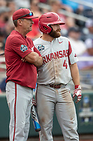 Arkansas Razorbacks head coach Dave Van Horn talks with leadoff hotter Trevor Ezell (4) before Game 5 of the NCAA College World Series against the Texas Tech Red Raiders on June 17, 2019 at TD Ameritrade Park in Omaha, Nebraska. Texas Tech defeated Arkansas 5-4. (Andrew Woolley/Four Seam Images)