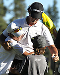 Scott Piercy gets a hug from his sons Cole, 13, left, and Brennan, 8, after winning the Reno-Tahoe Open at the Montreux Golf & Country Club in Reno, Nev., on Sunday, Aug. 7, 2011. .Photo by Cathleen Allison