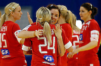 BELGRADE, SERBIA - DECEMBER 15:  Mette Gravholt (R) and Laerke Moller (L) of Denmark celebrate victory against Russia after the Women's European Handball Championship 2012 fifth place match between Denmark and Russia at Arena Hall on December 15, 2012 in Belgrade, Serbia. (Photo by Srdjan Stevanovic/Getty Images)