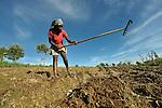 Joselin Jerome, 19, rakes a farm field in the mountainous community of Foret-des-Pins, Haiti.