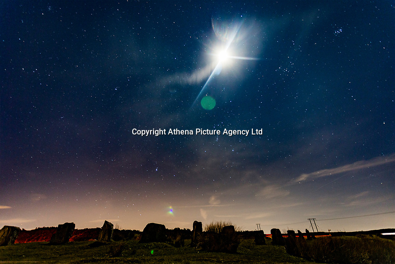 A half moon and stars visible over Keepers Pond, Pontypool, Wales, UK.<br /> Re: Below zero temperatures have hit most parts of the UK this month. This month will also have no full moon, a rare phenomenon which only happens during the month February and is known as Black Moon with January and March experiencing Blue Moons.