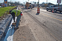 A concrete saw is used to cut  breaks in freshly laid concrete curbs on Westerville Road at Dempsey as roadway improvements near completion at the intersection. The changes are part of an improvement project at the I-270 interchange to upgrade the entrance road to Westerville, OH.