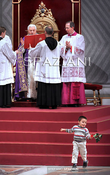 A child has escaped from his mother to meet the Pope at the altar,Pope Benedict XVI during the celebration of the first Vespers in the St. Peter's Basilica in Vatican on November 27, 2010.