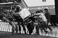 Jornada de apoyo a los prisioneros polviticos encarcelados po la dictadura, la accion fue convocada por familiares de los presos y organizaciones de derechos humanos. Policvias detienen a manifestantes.<br /> Santiago Chile 10 Diciembre 1987<br /> <br /> Forty years ago, on September 11, 1973, a military coup led by General Augusto Pinochet toppled the democratic socialist government of Chile. President Salvador Allende was killed during the  attack to seize  La Moneda presidential palace.  In the aftermath of the coup, a quarter of a million people were detained for their political beliefs, 3000 were killed or disappeared and many thousands were tortured.<br /> Some years later in 1981, while Pinochet ruled Chile with iron fist, a young photographer called Juan Carlos Caceres started to freelance in the streets of Santiago and the poblaciones or poor outskirts, showing the growing resistance against the dictatorship. For the next 10 years Caceres photographed every single protest and social movement fighting for the restoration of democracy. He knew that his camera was his only weapon, he knew that his fate was to register the daily violence and leave his images for the History.<br /> In this days Caceres is working to rescue and organize his collection of images in the project Imagenes de la Resistencia   . With support of some Chilean official institutions, thousands of negatives are digitalized and organized to set up the more complete visual heritage of this  violent period of Chile´s history.
