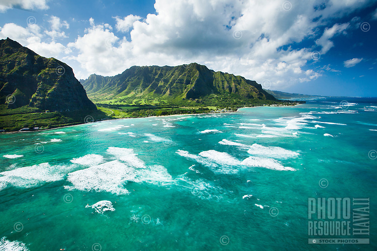 An aerial view of waves rushing towards Ka'a'awa Valley on O'ahu.
