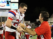Manatee Hurricanes quarterback Cord Sandberg #24 receives congratulations from principal Bob Gagnon after the Florida High School Athletic Association 7A Championship Game at Florida's Citrus Bowl on December 16, 2011 in Orlando, Florida.  Manatee defeated First Coast 40-0.  (Photo By Mike Janes Photography)