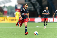 FOXBOROUGH, MA - JULY 25: Matt Polster #8 of New England Revolution brings the ball forward during a game between CF Montreal and New England Revolution at Gillette Stadium on July 25, 2021 in Foxborough, Massachusetts.