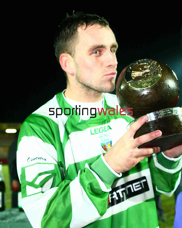 From James Benwell/SPORTINGWALES/21-03-2007/Newport County FC vs The New Saints FC. Action from the FAW Premier Cup Final at Newport Stadium. Goal scorer Steve Beck kisses the trophy at the end of the game.