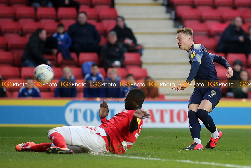 Cauley Woodrow scores Barnsley's opening goal during Charlton Athletic vs Barnsley, Sky Bet EFL Championship Football at The Valley on 1st February 2020